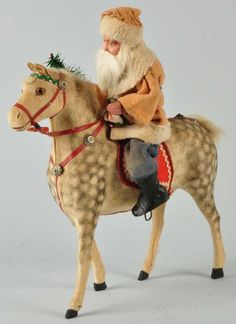 "Santa/Belznickle Riding Horse.Composition face and hands and glass eyes. Size 14 - 1/2"" T., 5,100 dollars, Morphy Auctions"