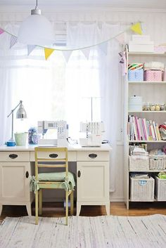 sewing room. Feels so cheery and bright! Like the desk and set up. But for the book case I would replace with a more antique looking bookcase/storage.