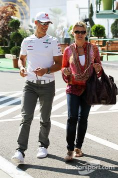 Michael Schumacher, Mercedes AMG with wife Corinna Schumacher at Hungarian GP High-Res Professional Motorsports Photography Michael Schumacher, Car And Driver, F 1, Mercedes Amg, Her Style, Grand Prix, Race Cars, Ferrari, Racing