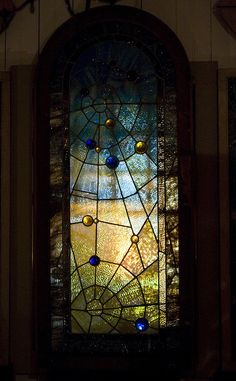 One of many spider-web motif stained glass windows at Winchester Mystery House, San Jose, California.  Supposedly, Sarah Winchester believed the webbed windows could catch bad spirits.  by ehoyer