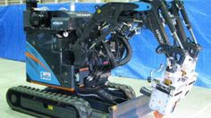 A rubble removal robot developed by Hitachi will begin operations at the crippled Fukushima Daiichi nuclear plant next year.