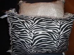 Kneel pillows: make your own.  Zebra fabric on bottom side.  White & glitter chiffon on top section with roses and ribbons on each corner.