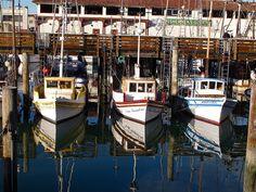 Fishing boats reflecting at the Wharf