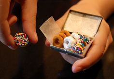 DIY :: Donuts for the Elves  ::  cheerios dipped in chocolate, then sprinkles. The others are cheerios dipped in confectioners' sugar and cheerios rolled in cinnamon sugar