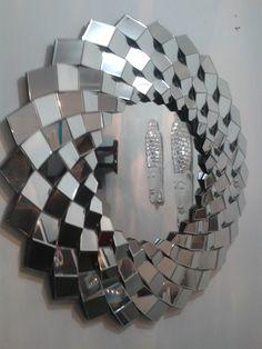 http://articulo.mercadolibre.com.co/MCO-415353872-espejos-modernos-importados-100x100cm-_JM