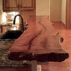 nice Natural wood bar counter top except the one is twenty feet long and can seat ten people.