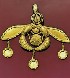 Bronze age Etruscan gold bee with applique and granulated ornament showing two bees are on a honey comb C.1600BC Crete