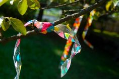 Outdoor Streamers - To make your own, lay down strips of inexpensive packaging tape with the sticky side up, and invite your child over to sprinkle bits of tissue paper on top.