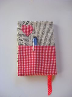 something like this... not the newspaper thing exactly, but i love the colors and the heart and the pen pocket