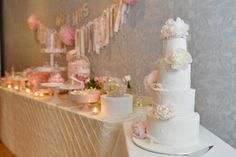Bells at Killcare wedding dessert table in pastel pink, yellow and white. Gorgeous wedding cake with fresh peonies in foreground.
