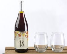 Fall Leaves Wine Label Table Numbers (1-20). Chilly fall nights and a great bottle of wine often go hand in hand. We like to think so, at least, which is why we designed these Wine Label Table Numbers, adorned with colorful fall leaves in vibrant shades of golden yellow, deep orange, and rustic brown. Available in a set of 20 (numbers 1-20), guests will never get lost trying to find tables at your fall-inspired wedding! Features and facts:  Adhesive wine bottle label table numbers in a...