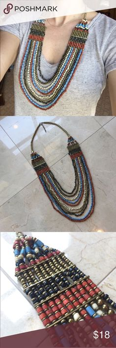 """BOHO TRIBAL NECKLACE Multi-Colored Beaded This is a really pretty Tribal inspired Boho multi-colored Beaded necklace. Has a variety of deep red, blue, black, ivory and gold beads. Pretty round bead detail at the top of necklace. Adjustable closure. 16"""" from top to bottom when closed. *Bundle & save 15% off* Jewelry Necklaces"""