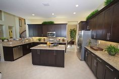Wow this kitchen is huge! The Buttonwood model home #glhomes --http://www.glhomes.com/the-preserve-at-bay-hill/new-homes/preserve/buttonwood