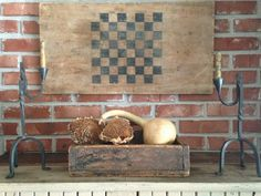 old game board, old tote filled with dried sunflower heads and gourd. repro rush lights.