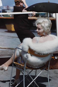 "In costume, Marilyn Monroe relaxes between takes in this photo from the set of ""Some Like It Hot,"" one of a number of previously unseen shots"