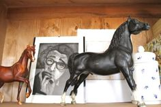 Nice photo of 2 Breyer Horses. I could see a black and white photo with two black Breyer Horses surrounding the picture (or pictures) on a tables cape for a wedding.