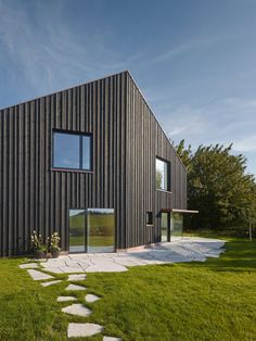 This house in the Bavarian countryside by local office SoHo Architektur has a kinked facade