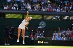 Elena Vesnina serves against Serena Williams on Centre Court