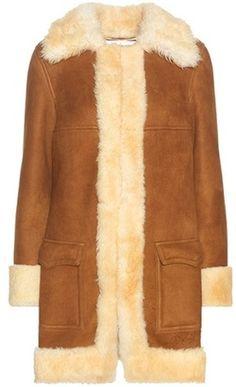 Shop Now - >  https://api.shopstyle.com/action/apiVisitRetailer?id=530964378&pid=uid6996-25233114-59 Saint Laurent Suede And Shearling Coat  ...