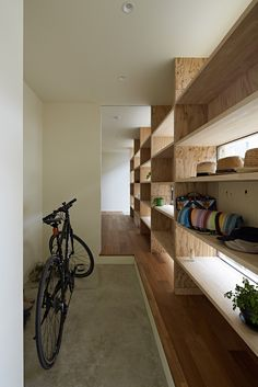 A wall of wooden shelves in a home in Japan.