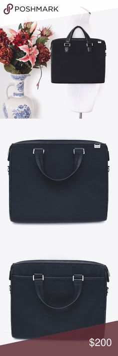 """Black MacBook 13-Inch Padded Laptop Bag TUMI  ⌁ Measurements: 13"""" length 10.5"""" height 2"""" depth 2.5"""" handle drop  ⌁ Material: nylon/canvas (?)  ⌁ Fits: MacBook Air 13"""" (maybe Pro 13"""" & other 13"""" laptops too)  ⌁ Condition: Used. Has scratch marks as well as some wear on the leather piping. Does not come with the long strap.  Comment below if you have any questions. Please make all offers using the """"offer"""" button. No trades. No holds. Comes from a smoke-free/pet-free home. Not responsible for…"""