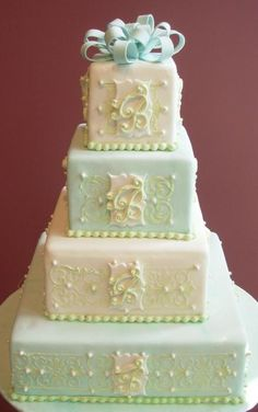 Gorgeous 4 tiered cake, blue and white with filigree scrolls, and monogram