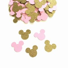 Minnie Mouse Birthday - Gold And Pink Confetti - Minnie Mouse Confetti - Minnie Mouse Birthday Party - Minnie Mouse Party Decorations  Make your childs Minnie Mouse Birthday party memorable with this absolutely adorable Minnie Mouse confetti. Decorate your party tables to compliment your centerpieces or add a little flair to your cake table. Bring your whole party design together with party confetti. •Comes in 100 pieces package. •Gold Glitter and Pale Pink pieces. •Made from heavy weight…