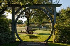 Moon Gate circlular view of beech seat round tree focal point lawn at Latchetts Sussex child friendly childrens garden   --  photo by John Glover Photography - garc.338 Moon Gate