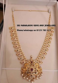 Beautiful long haaram with mango hangings. Long haaram studded studded with multi precious stones. Haaram with matching jumkhis. Showing here a mango haaram 100 gms Jhumke 30 gm. Visit for full variety. Contact no 8125 782 New Necklace Designs, Gold Earrings Designs, Gold Jewellery Design, Gold Jewelry Simple, Bridal Jewelry, Fashion Jewelry, Gems, Gold Necklace, Mango Necklace