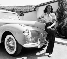 1941: American screen beauty Rita Hayworth poses beside another classic beauty