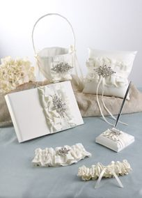 Ruffled matte satin ruffles finished with a Vintage inspired jeweled piece.The Gift Set includes: Guest Book, Ring Pillow, Flower Girl Basket, Penholder, and Garter Set. #davidsbridal #greatgatsby #gatsby