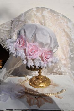 This Victorian silk shower hats are the perfect accessory for your baby, can be worn many different ways and for many different occasions such as Christenings, photoshoots, as you can see the differen