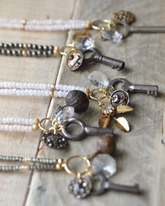 Gemstone and antique charm necklaces. Small skeleton keys, antique 1800s buttons, chandelier crystals and more.