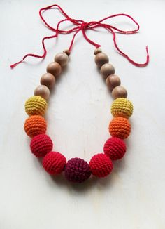 This crochet necklace is the perfect and popular eco-toy for a baby and stylish jewelry for moms . A nursing necklace tenderly calls to your baby's senses - vision, touch and hearing. Crocheted beads help your little ones to improve their fine motor skills and bright colors catch their attention. I make stylish and functional nursing necklaces made of natural materials. The necklace is made of fragrant juniper beads 12 mm in diameter , tied with beads about 15 mm in diameter