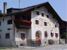 Schuls / Scuol, Engadin     House with a sundial and decorations   Switzerland