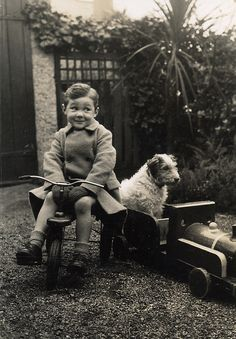 ::::::: Vintage Photograph :::::::::   Adorable boy and his dog ever faithful sitting in the toy train.