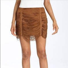 """FABULOUS Haute Hippie leather suede skirt!  Very sexy and eye catching brown suede skirt from Haute Hippie. One of my favorite brands. I loved this skirt!  12 inches from waist to hem of skirt, however the """"fringe"""" hangs 2-3 inches lower. The waist is 15 inches across and has a side zipper. Metal studs all in tact. This skirt is meant to sit low on the hips. You WILL stand out in this! I got so many compliments when I wore it with a tight white tank and Dior heels! ❣ Haute Hippie Skirts Mini"""