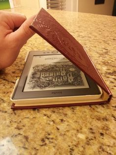 how to make a kindle cover from an old book.  Great idea to use with a leather journal with my tree design