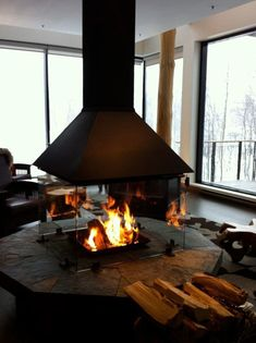 Cosy fireplace at Hotel Premiere Nations, – Freestanding fireplace wood burning