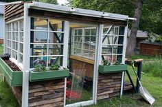 Want a greenhouse but don't want to spend a whole lot? Check out this great build. Free pallet racks and other repurposed materials make this a cheap build. Greenhouse Kitchen, Pallet Greenhouse, Window Greenhouse, Outdoor Greenhouse, Cheap Greenhouse, Greenhouse Interiors, Backyard Greenhouse, Greenhouse Plans, Pallet Gardening