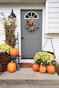 Simple fall porch decor & a door makeover - Door color is Kenadall Charcoal by Benjamin Moore Front Stoop, Front Doors, Barn Doors, Front Porch Makeover, Decoration Inspiration, Decor Ideas, Exterior Makeover, Fall Door, Front Door Decor