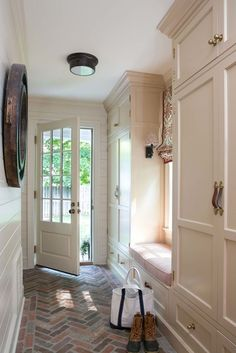 brick flooring Mudroom ideas for different spaces! Get ideas for how to design a mudroom for small spaces, laundry rooms, hallways, and more. Flur Design, Mudroom Laundry Room, Mudroom Cabinets, Mud Room Lockers, Hallway Cupboards, Floor To Ceiling Cabinets, Kitchen Cabinets, Brick Flooring, Penny Flooring