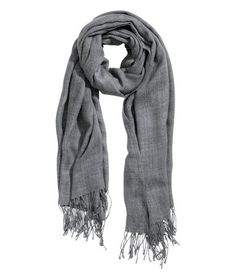 Dark gray. Scarf in a soft, fine knit with fringe at ends. Size  39 1/4 x 86 1/2 in.