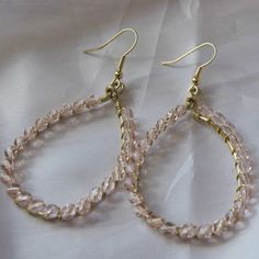 Craft a delicate pair of DIY earrings with this tutorial for Beautiful Wire Wrapped Teardrop Earrings. Precious in pale pink, this dainty teardrop earrings designs are subtle, yet style stunning.