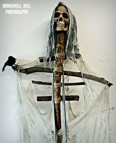 DIY Halloween decoration instead of buying a full skeleton, save money by using tree branches for the body! In my opinion, this looks SO much cooler - it has that Blair Witch feel!