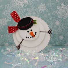 Using this as the inspiration, I'm going to make these as tree ornaments. Use real twigs for the arms, felt for the snowman and hat. Beads would work for the coal and can make more carrot buttons. (did one year from orange polymer clay- they worked perfectly).