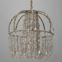 Circa 1900 Unusual All Beaded French Fixture -- Turn of the century French fixture has a delicate ribbed basket-form metal frame completely covered with white and silver glass seed beads and several strands of heavy clear glass beads draping down from the top center of the fixture and anchored to outside bottom of the frame. There is a single internal light socket and bronze canopy. New wiring for US electrical standards. --  Item:  6101 -- Retail Price:   $3295