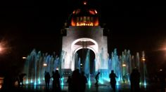 "Spring Night: Color lights on the fountain at ""Monumento a la Revolución"" in Mexico City."