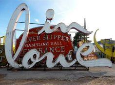 'In Love' sign in the Neon Boneyard, Las Vegas by louise