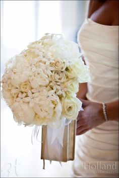 lush, white, wedding bouquet, crystal embellishments, roses, formal, bible attached to bouquet, white peonies, white garden roses, stephanotis with rhinestone centers, white phaelanopsis orchids, soft cascading, holland photo arts photography, wedding planning by Stacy Black Becher of Caroline LaRocca Event Design